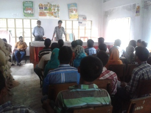 Elias Kanchon giving training with Md. Borhan Uddin, the Kishoreganj District's Jubo Union officer